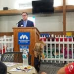 Pastor speaking at Metropolitan Ministries' Holiday Service in Pasco